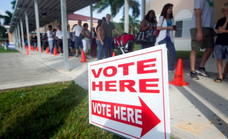 People stand in line to vote early Sunday, Oct. 28, 2012, in Pembroke Pines, Fla. On the only Sunday that Florida polls will be open for early voting this election cycle, faith leaders from 44 congregations in six Florida cities will lead their congregations to early voting locations in a massive